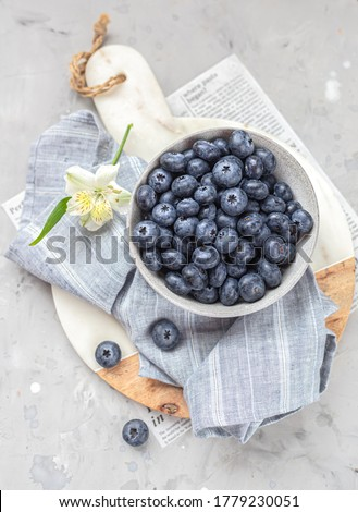 Fresh raw organic blueberries with leaf in white cup from enamel on white background. Vintage food p Stock photo © DenisMArt