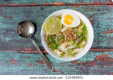 Soto is a traditional Indonesian soup mainly composed of broth, chicken and vegetables BANNER, long  Stock photo © galitskaya