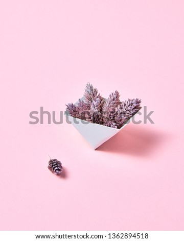 Composition of paper triangular boxes with cones on a pink background with copy space. Layout for po Stock photo © artjazz
