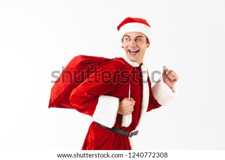 portrait of joyful man 30s in santa claus costume and red hat ru stock photo © deandrobot