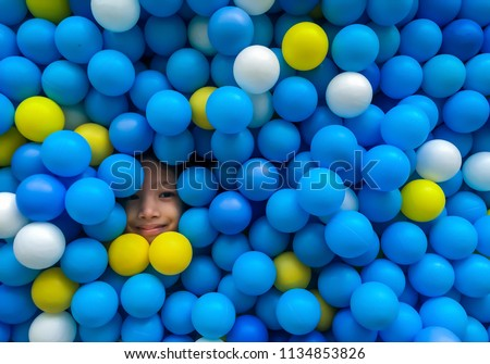 Children playing in ball pit. Colorful toys for kids. Kindergarten or preschool play room. Toddler k Stock photo © galitskaya