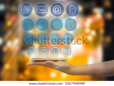 hand with phone with application blue icons panel over blurred city at night background stock photo © wavebreak_media