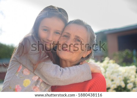 Front view of a grandmother and granddaughter looking at photo album in living room at home Stock photo © wavebreak_media