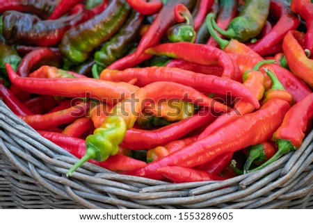 Small red chili peppers in the wicker basket on the Vietnamese market Stock photo © galitskaya