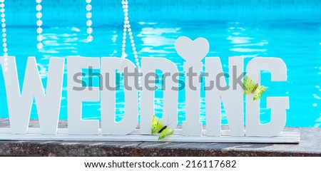 Wedding dress at the hotel on the background of the pool, ocean and mountains Stock photo © galitskaya