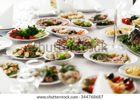Catering service. Restaurant table with food. Huge amount of food on the table. Plates of food. Dinn Stock photo © galitskaya