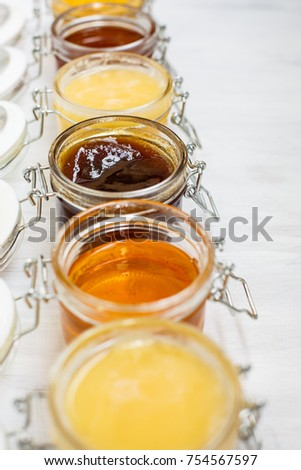 Healthy food table with different kinds of honey, fresh ginger and lime Stock photo © dash