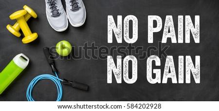 Fitness equipment on a dark background - No pain no gain - Ohne  Stock photo © Zerbor
