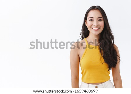Portrait of pleasant looking female model with dark long hair, looks confidently at camera, has make Stock photo © vkstudio
