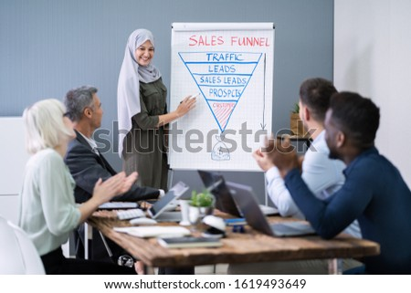 Colleagues Applauding To Muslim Businesswoman After Presentation Stock photo © AndreyPopov