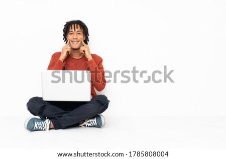 smiling man pointing finger to his head at office Stock photo © dolgachov