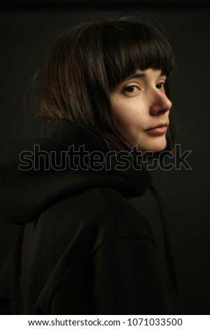 Woman with short hair adult on a monochrome background in the Studio Stock photo © ElenaBatkova