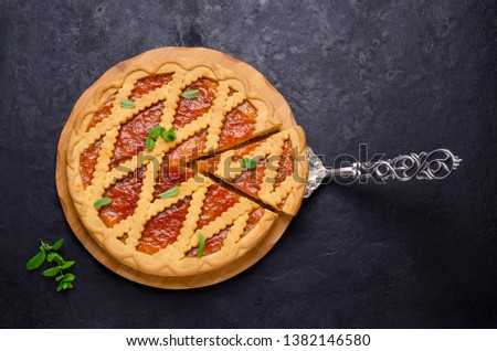 Fresh baked crostata with marmalade or apricot jam filling on br Stock photo © marylooo