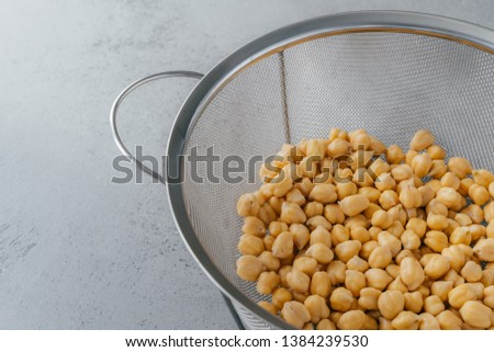 Organic seeds in sieve. Dry chickpeas for healthy eating. Overhead view. Nutrient dense food. Garban Stock photo © vkstudio