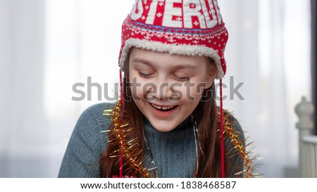 Sincere emotions. Little cute girl in knitted hat and white warm Stock photo © vkstudio