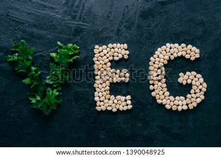 Parsley and dry garbanzo in form of letters meaning veg, vegetarian isolated over dark background. O Stock photo © vkstudio