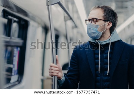 Sick man breathes through medical mask, travels by public transport, protects from getting coronavir Stock photo © vkstudio