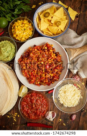 Mexican food concept. Vegetable burritos. Served on pan. Tortilla guacamole, salsa, chilli and beans Stock photo © dash