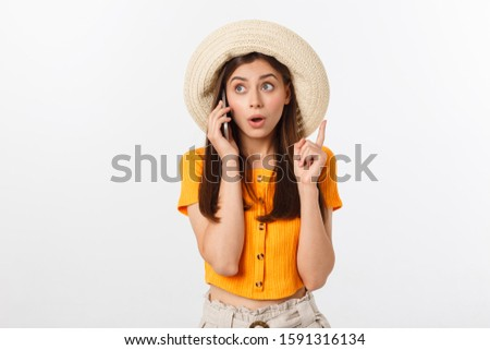 Photo of amazed brunette woman smiling while looking at camera Stock photo © deandrobot