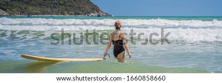 BANNER, LONG FORMAT Beautiful young woman ride wave. Sporty surfer woman surfing on the background o Stock photo © galitskaya