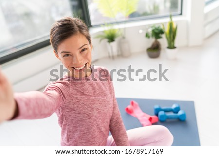 Happy selfie at home Asian young woman smiling training bodyweight exercises on exercise mat in livi Stock photo © Maridav