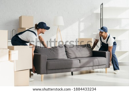 happy indian man holding floor lamp at home Stock photo © dolgachov