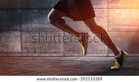 Fitness athlete man running on asphalt sidewalk in city street. Sport lifestyle. Closeup of lower bo Stock photo © Maridav
