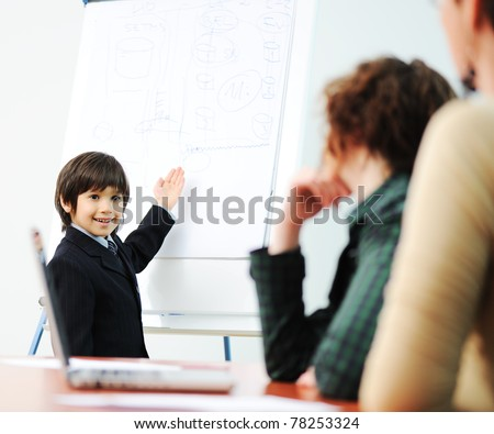 Genius kid on business presentation speaking to adults and giving them a lecture stock photo © zurijeta