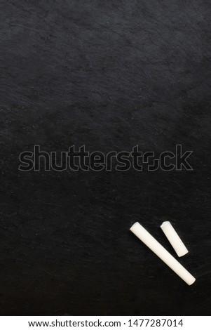 A+ grade on black chalkboard with copy space.  Chalk dust on board.  Stock photo © dehooks