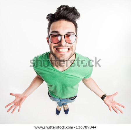 View from above of man in glasses looking at camera with hands o Stock photo © HASLOO