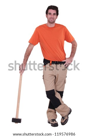 Handyman wearing patched trousers and leaning against a mallet Stock photo © photography33