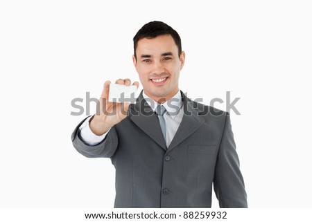 Young businessman showing his businesscard against a white background Stock photo © wavebreak_media