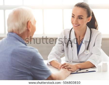 gülen · kadın · doktor · oturma · büro · eller - stok fotoğraf © wavebreak_media