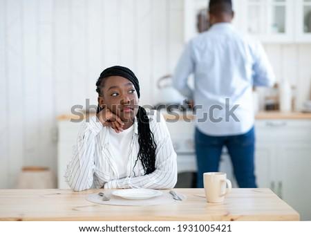 Portrait of a woman preparing to her husband or boyfriend surpri Stock photo © HASLOO