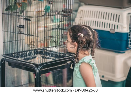 Piccolo ragazza pappagallo bambini occhi faccia Foto d'archivio © taden