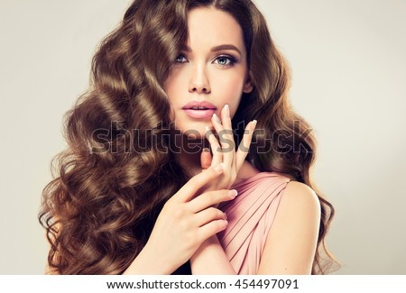 Hair. Beautiful Brunette Girl. Healthy Long Hair. Manicured nail Stock photo © Victoria_Andreas