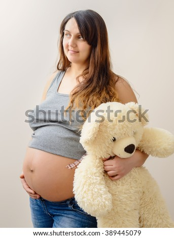Tenderness. Sentiment. Daydreaming Woman with Teddy Bear Laying Stock photo © gromovataya