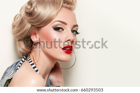 Portrait of a beautiful young woman with a glamorous retro makeu Stock photo © vlad_star
