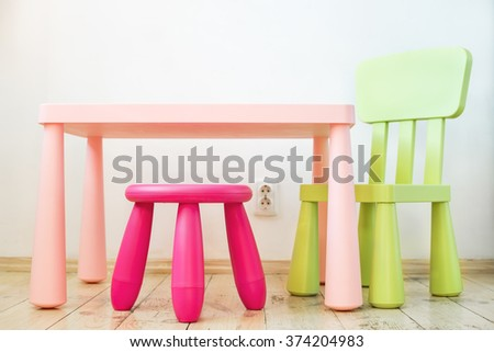Small pink plastic stool for kids isolated on soft floor indoor  stock photo © yanukit