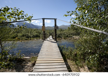 Bridge over clean and clear river in the forest, Rondane Nationa Stock photo © slunicko