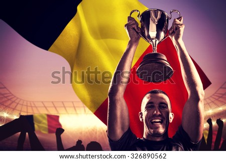 composite image of portrait of successful rugby player holding t stock photo © wavebreak_media