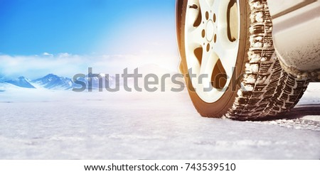 close up image of winter car tire on snowy road with space for your text drive safe concept stock photo © maxpro