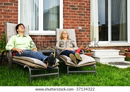 Young smiling woman and man reclining on chaise lounges in hotel Stock photo © Paha_L