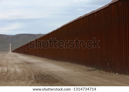 Fence Seperating Mexico From California United States Mexican Bo Stock photo © cboswell