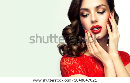 Beautiful girl with long wavy hair in red dress. Brunette with c Stock photo © Victoria_Andreas