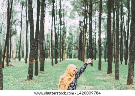 beautiful arabic girl with scarf over forest background double e stock photo © zurijeta