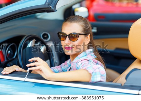 Woman sitting in a convertible car with the keys in hand - conce Stock photo © vlad_star