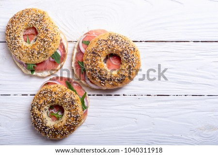 Toasted bagels with cream cheese and herbs on marble countertop  Stock photo © tab62