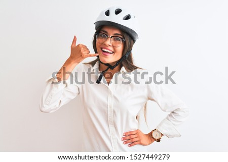 Young friendly businesswoman wearing glasses isolated on white  Stock photo © gravityimaging