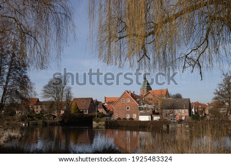 st nicolai church and old half timbered houses in quedlinburg stock photo © meinzahn